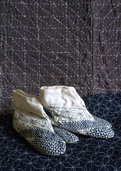 "A pair of exceptionally fancy, yet rustic 足袋 (tabi) or the traditional split-toe ""socks"" of Japan. These white cotton tabi are hand sashiko-stitched in indigo dyed cotton yarn. 藍染の麺糸で刺し子縫いしたシブ〜い足袋。"