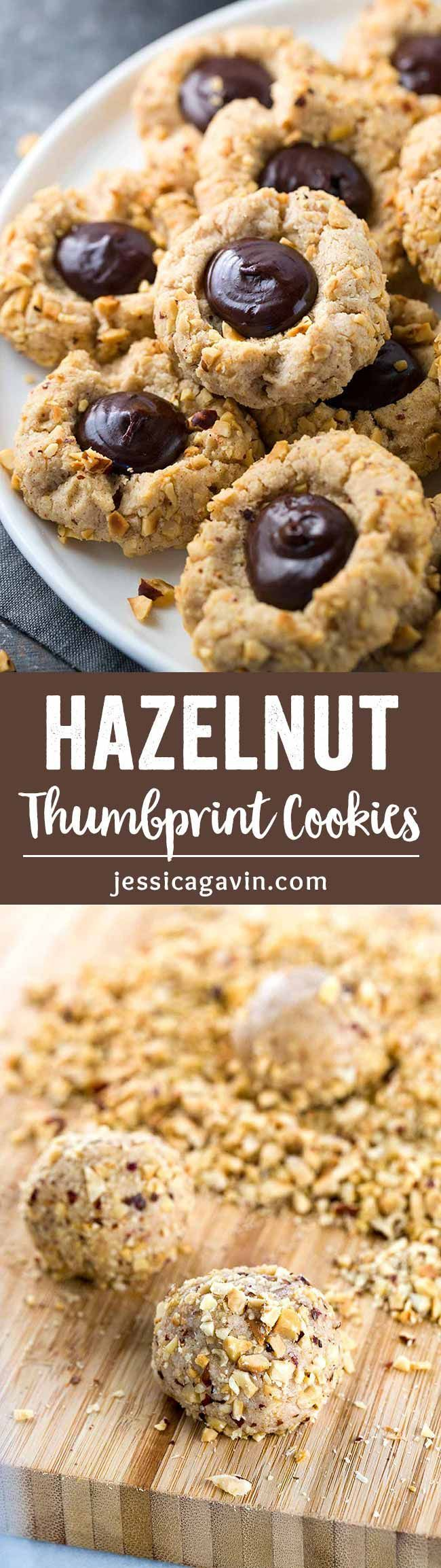 Gluten Free Chocolate Hazelnut Thumbprint Cookies - These decadent sweet treats are so simple to make! Rolled in crunchy hazelnuts and filled with silky chocolate ganache. via /foodiegavin/