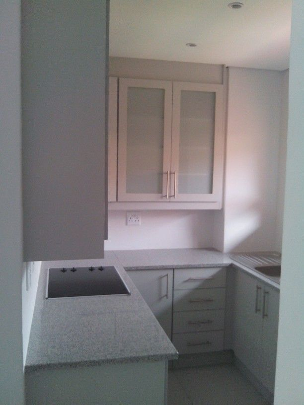 Windsor grey melamine with frosted glass door wall cupboards
