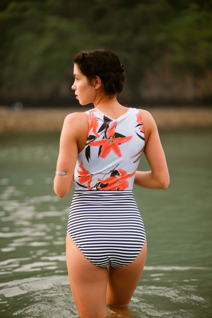 The Sea Glass Bombshell Swimsuit. Zipper? Check. Signature Albion floral and stripe combo? Check. Check. Our Sea Glass Bombshell swimsuit features another winning combination of sophistication and stylish flair, all the while providing the coverage and the comfort you're looking for in that perfect suit. Two distinguishing panels of florals and stripes keep that torso looking long and lean and sturdy, luxurious fabric keep you held in, in all the right places. | @albionfit