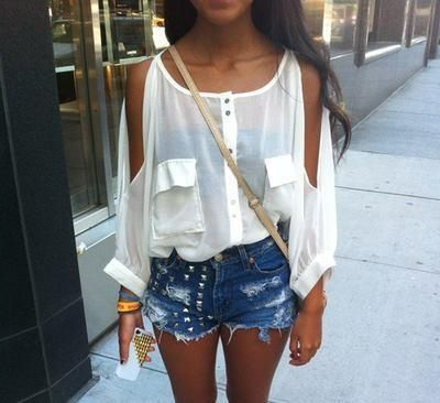 Lovely outfit. This sheer top with sleeve slits paired with the washed out and faded cut off jean shorts.