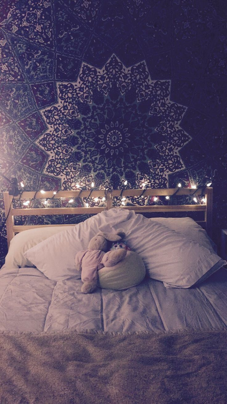 bohemian bedroom with christmas lights and tapestry                             …