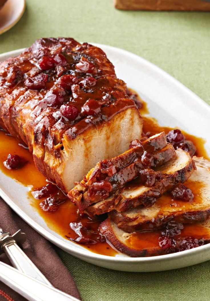 Slow-Cooker Cranberry-Orange Pork Roast — Cranberry sauce and the juice and zest of an orange work their tasty magic in the slow cooker so you can come home to a sweet and tart roast pork loin.