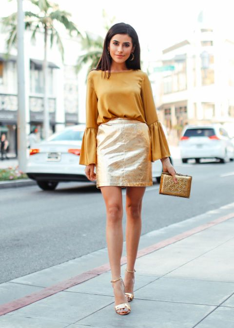"Go bold and super festive for a dinner party, playing with fabrics and shapes that wouldn't fly for the office. ""When I think of the holidays, the color gold instantly comes to mind. This look would be great for an intimate dinner party."" - blogger Sazan Hendrix Rochas blouse, $975, matchesfashion.com; Edie Parker clutch, $1,295, neimanmarcus.com; Tory Burch sandals, $295, nordstrom.com; Anine Bing skirt, $499, aninebing.com"