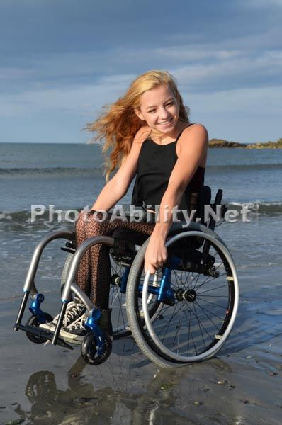 Young Woman In A Wheelchair On A Beach Imagery By