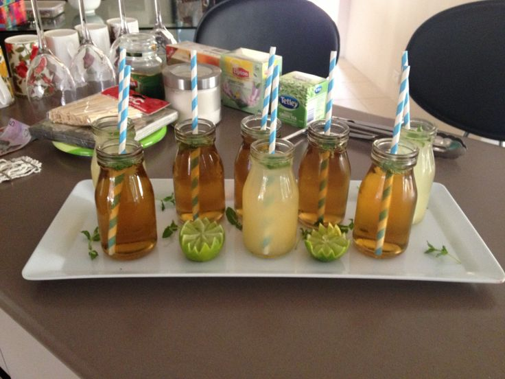 Ginger apple and mint and pineapple and lemon mocktails in mini milk bottles