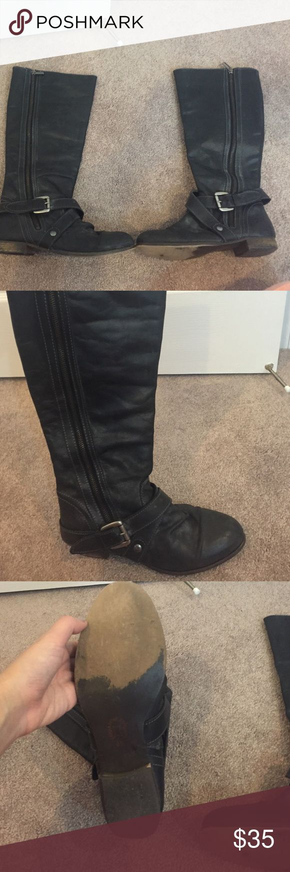 Steve Madden black boots Distressed black leather with buckle, slightly scuffed bottoms but still in great condition. Steve Madden Shoes Winter & Rain Boots