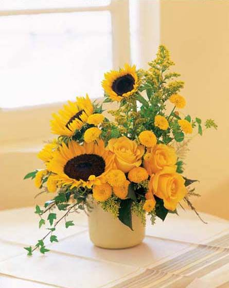 Sunflower Centerpiece Arrangement. Maybe with white roses for wedding?