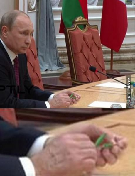 President Vladimir Putin snapping a pencil in half during the peace negotiations in Ukraine