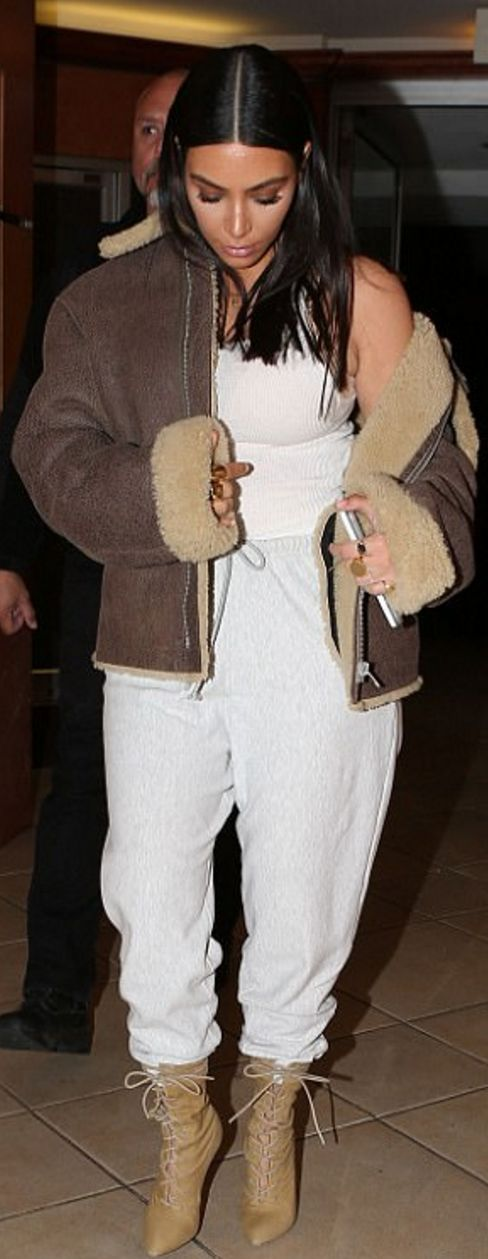 Who made  Kim Kardashian's brown leather coat and tan ankle boots?