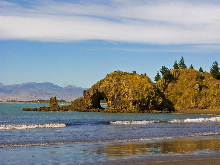 Whites Bay, with hole in the rocl,  see more at New Zealand Journeys app for iPad www.gopix.co.nz