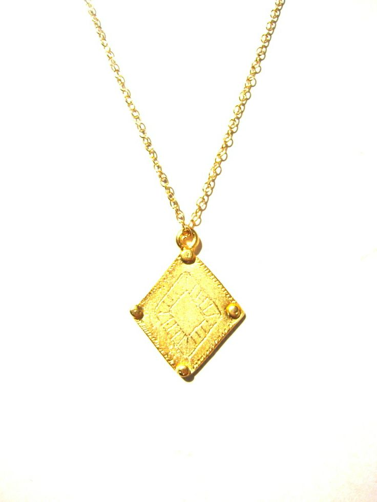 This beautiful gold plated necklace features an engraved diamond Aztec design. It is a solid charm with a flat back matte gold plated finish. Strung on a 14k gold filled chain with 14k gold findings. Standard chain length is 18 inches (45..5 cm)Can make a custom length chain.Charm dimensions-23mm x 30mm.Wrapped in Recycled packaging.FOLLOW MY INSTAGRAM FOR SPECIALS, AND A LITTLE FUN.http://instagram.com/bywisteriaFOLLOW MY FACEBOOK WHILST YOU'RE AT ...