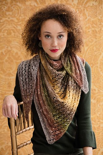 One skein of Lion Brand's Shawl in a Ball is all it takes to create this wrap. The shifting of the two pattern stitches—welt and lace—form two smaller triangles inside the right-triangle shape.