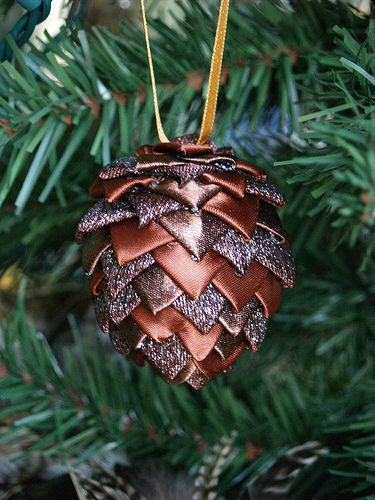 DIY ribbon pine cone ornaments. Uses Styrofoam egg, stick pins, and little bits of ribbon. Looks pretty cute to me! I wonder what I could use instead of Styrofoam?
