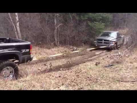 Lifted GMC Sierra 1500 pulling dodge 2500 cummins out of the mud - YouTube