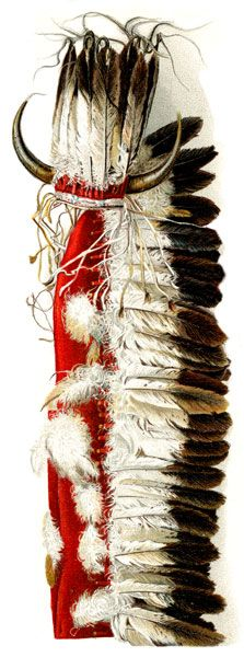 WAR BONNET ORNAMENTED WITH BUFFALO HORNS AND EAGLE FEATHERS ATTACHED TO RED FLANNEL