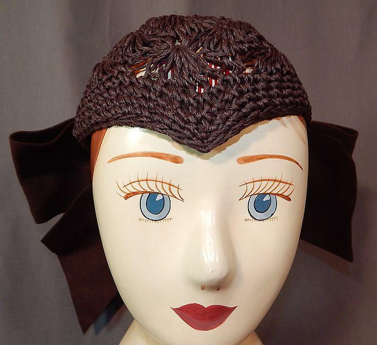 Vintage Modern Miss Brown Woven Raffia Wool Bow Trim Widows Peak Cloche Hat This vintage Modern Miss brown woven raffia wool bow trim widows peak cloche hat dates from the 1930s