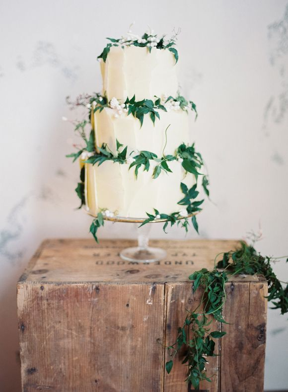 striking white cake accessorised with gorgeous green foliage