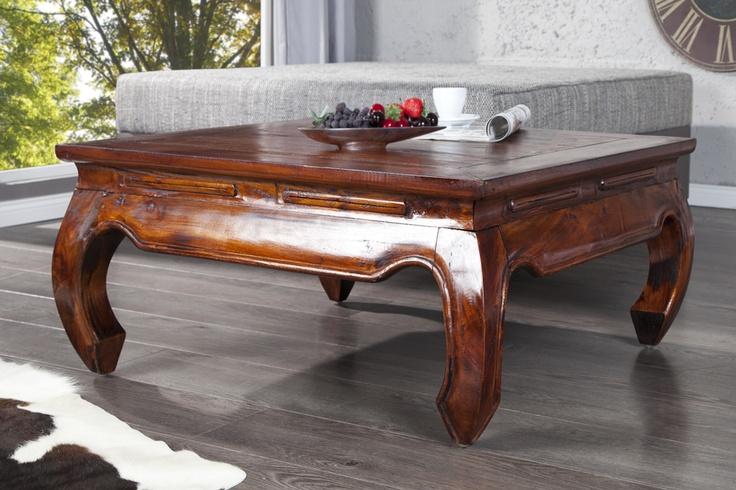 """Dieser formschöne Beistelltisch """"OPIUM"""" aus massivem Holz ist der ideale Tisch für Ihr Wohnambiente. Der Tisch vermittelt ein rustikales Urlaubsflair und überzeugt durch sein naturbelassenes und klares Design. Zu einem charakteristischen Blickfang werden die im asiatischen Stil geschwungenen Beine. Die großzügige Ablagefläche wirkt zudem nie überladen und unterstreicht dadurch zusätzlich den luxuriösen Auftritt."""
