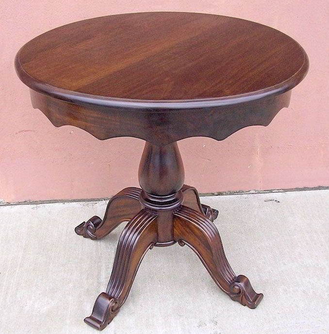 A beautiful accent table features regency style pedestal and round top.