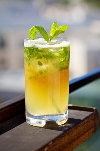 The Drink:Pineapple Mojito  Ingredients:White rum, fresh lime, puréed pineapple, and mint served long with a dark rum float.