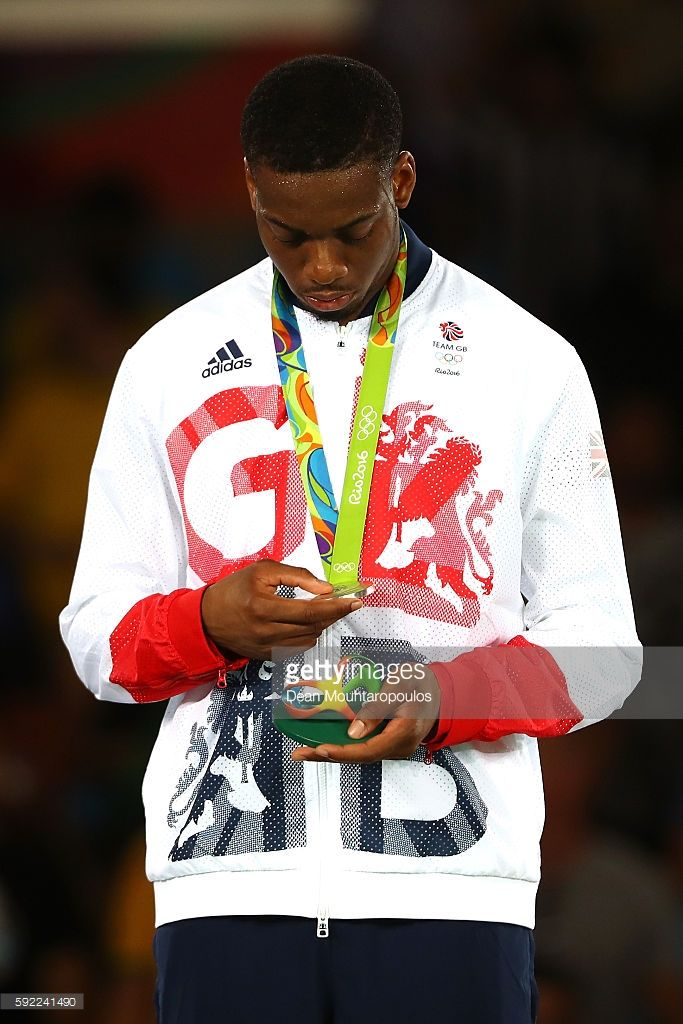 Silver medalist Lutalo Muhammad of Great Britain poses on the podium during the medal ceremony for the Men's Taekwondo -80kg Contest on Day 14 of the Rio 2016 Olympic Games at Carioca Arena 3 on August 19, 2016 in Rio de Janeiro, Brazil.