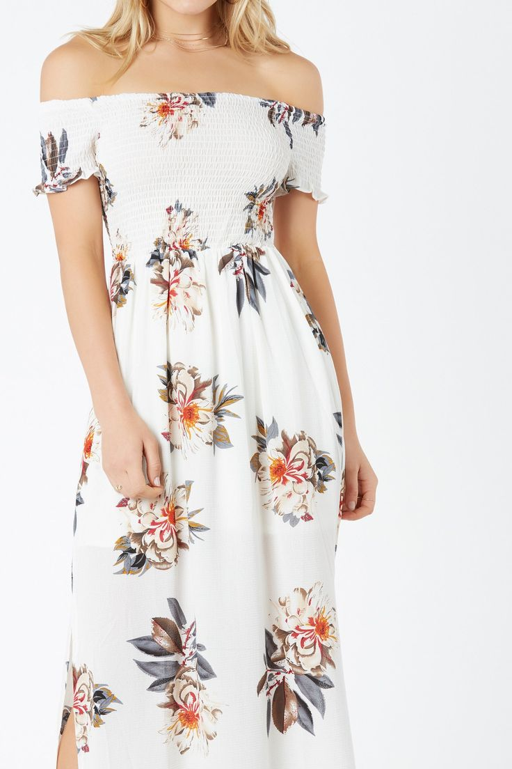 Flowy off shoulder maxi dress with floral print throughout. Fitted top with slit detailing at hem.