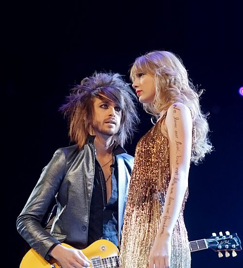 "Grant Mickelson and Taylor Swift in Melbourne, Australia. ""And The Story of Us looks a lot like a tragedy now..."" (speaks) ""The End!"""