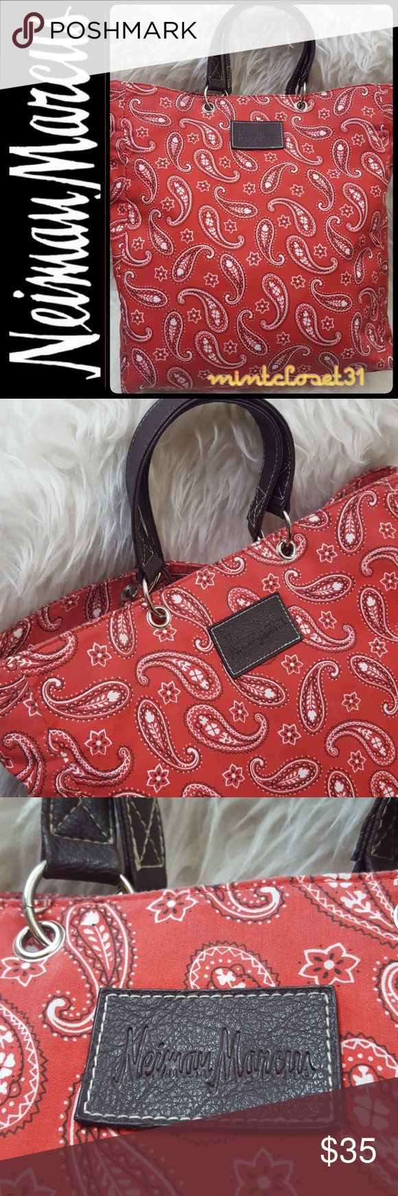 Neiman Marcus Tote Bag Neiman Marcus Designer Tote Bag in Red Canvas! Features the Iconic Neiman Marcus Logo Print on Front plate! Double Handles in silver Tone Rings with Open Top! Fully Lined Interior! Approx Size 7.5x9.5x4.5 Inches! Used in Good Condition! Neiman Marcus Bags Totes