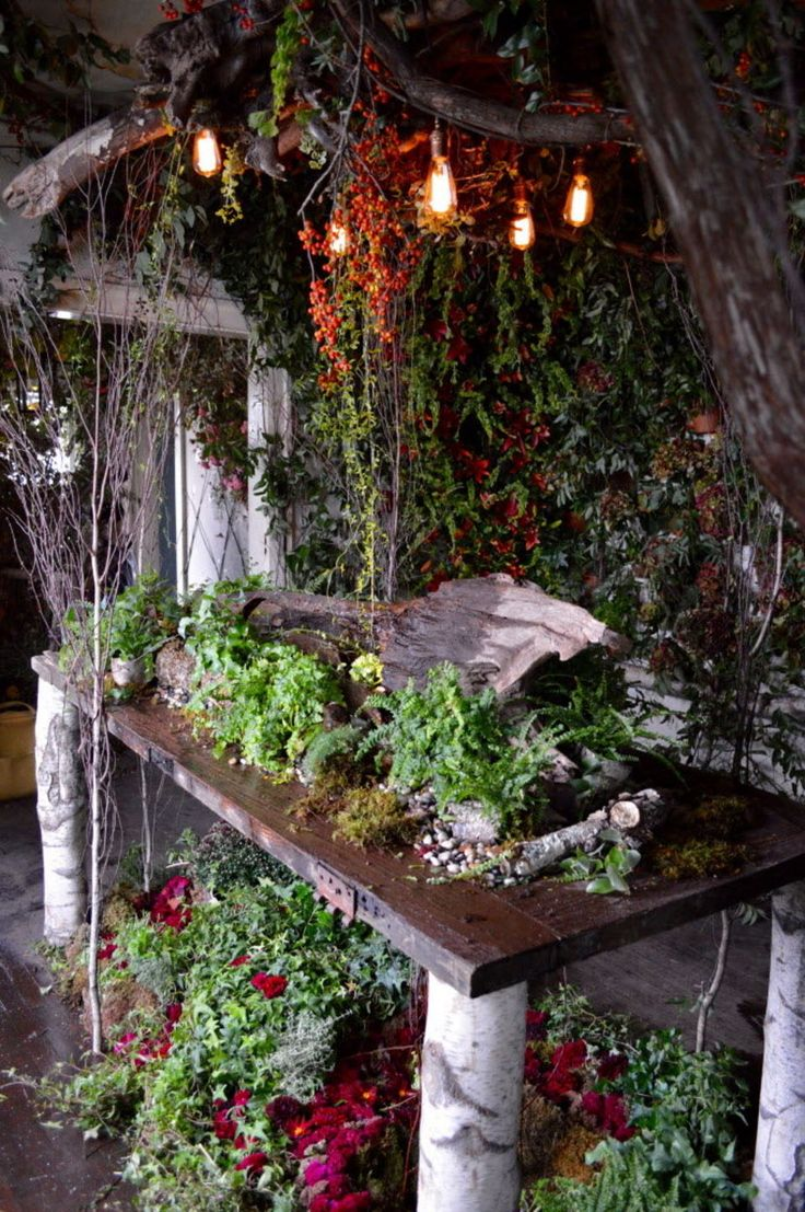 The dining room of Flower House has a table levitated on legs made of thick tree branches.