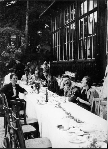 Eva Braun photo from 1935. Anni Brandt sits across from Hitler, who has his bottle of Fachinger in front of him. (via putschgirl)