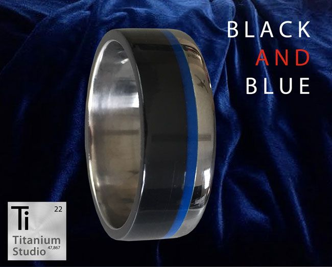 Black and Blue Titanium Mens Ring. Black teflon and blue resin inlay strip.