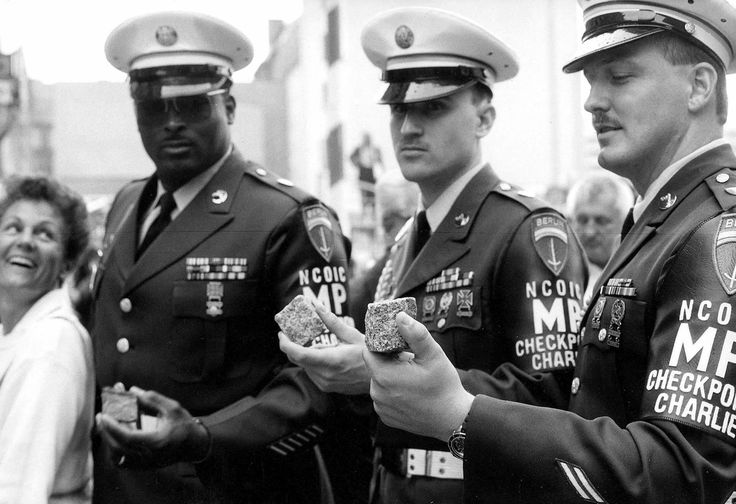 SGT Michael Rafferty (middle), SSG Nathaniel Brown (left) and SGT Ed Baldwin (right) at the closing ceremony of Allied Checkpoint Charlie, 22 June 1990.  Courtesy of the Mauermuseum