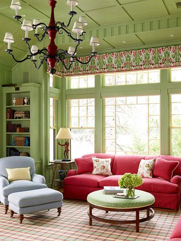 these windows are to die for... love the rosy-red sofa, but not crazy about the blue chair