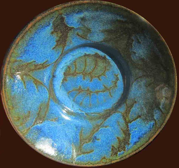 Wax resist cobalt over slip glaze, butter dish