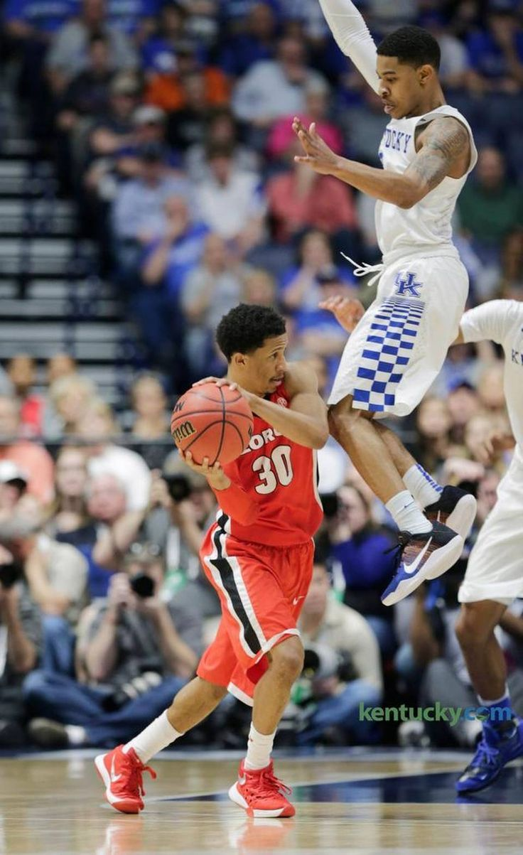 Kentucky guard Tyler Ulis (3) jumped while guarding Georgia's J.J. Frazier (30) in the second half of the Kentucky vs Georgia SEC Men's Basketball Tournament semifinal game at Bridgestone Arena in Nashville, Tenn., on March 12, 2016. Kentucky beat Georgia 93-80 and advance to the championship game against Texas A