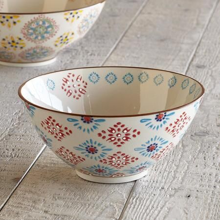 BOHEME SERVING BOWL, SMALL - A longtime favorite Sundance offering, a ceramic serving bowl that celebrates variety being the spice of life with a mismatched medley of medallion and floral patterns and colors.