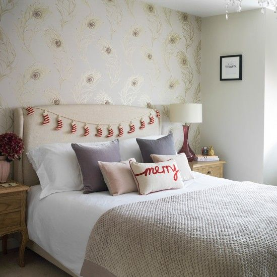 Cosy bedroom with peacock feather wallpaper
