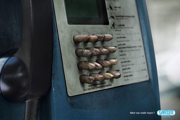 Grimy fingers symbolising germ contamination of phone booth.