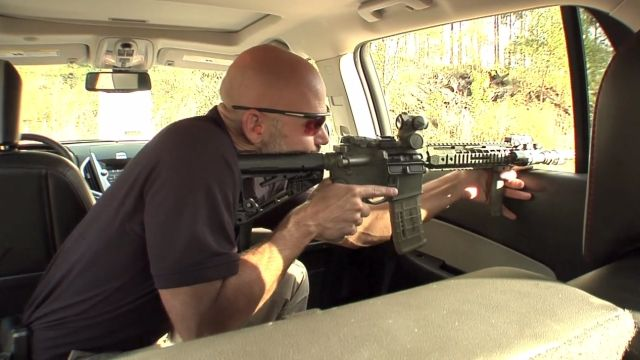 Rob Pincus demonstrates shooting inside a vehicle and how a vehicle's interior provides both cover and concealment.