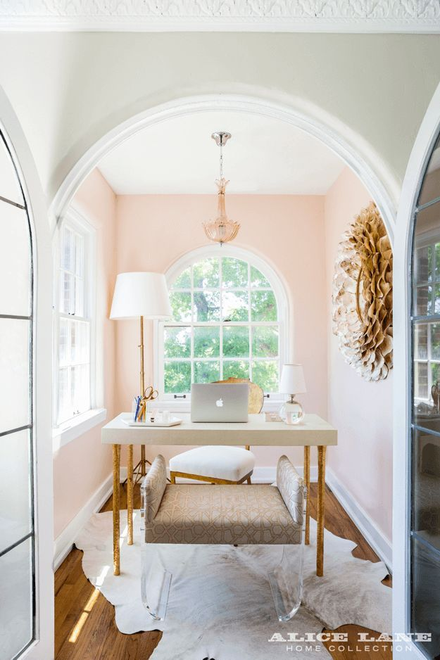 dusty pink home office with white trim, pantone pale dogwood, dusty peach, dusty rose, blush peach, blush pink, rose quartz, gold accents, white cowhide rug
