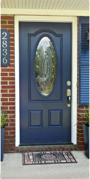 Warning: You need some serious skills to pull this transformation off. These homeowners didn't just add a coat of paint — they replaced the entire door for a navy blue style with a glass window center. See more at The Gardening Cook »    - HouseBeautiful.com