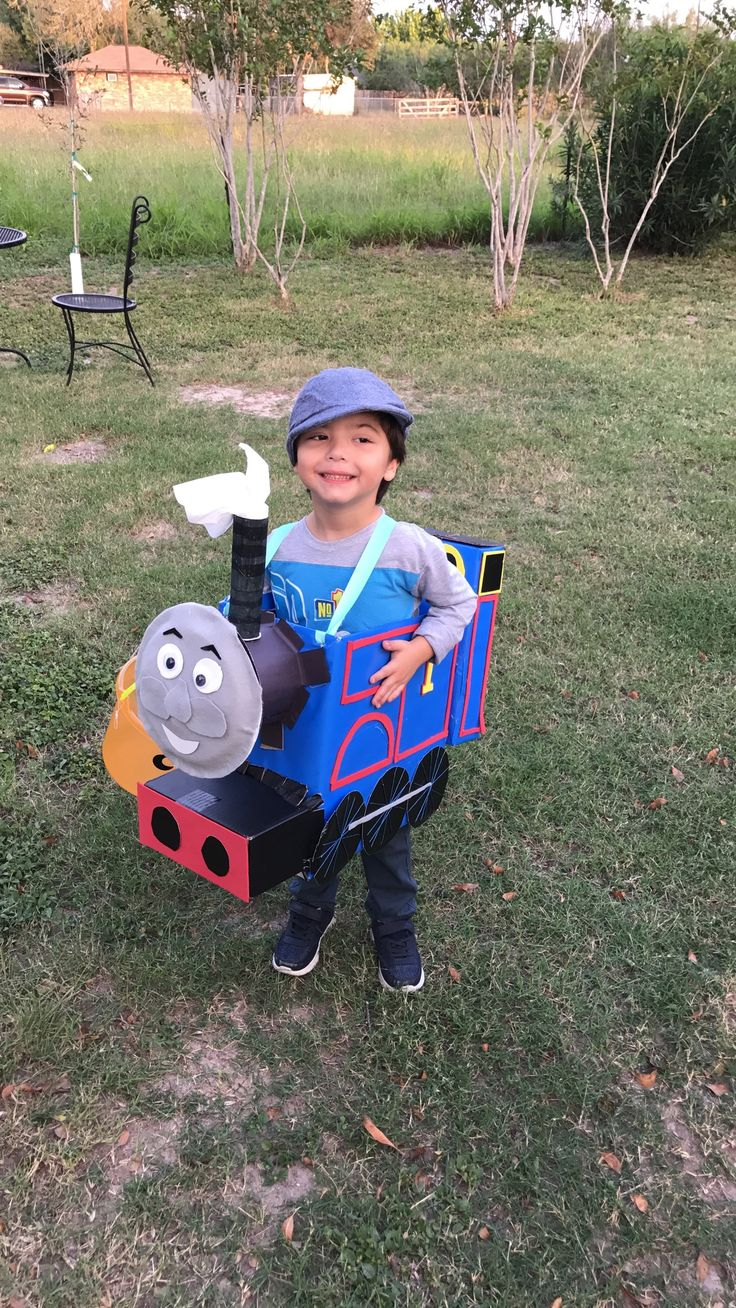 Thomas the train costume I made for my son. I used a huggies box and a cheerio box. I used paper plates and half a oatmeal container for face. I followed a tutorial video and made adjustments with supplies I had at home