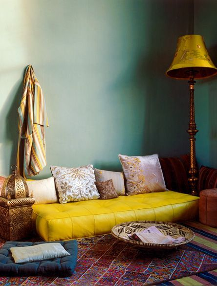 """From the blog: """"Be stylish without even trying by swapping your sofa for a rectangular floor cushion. Add layered rugs, baskets to double as coffee tables/media bins for the ultimate relaxed living room. Set off the lowness of it all with a tall lamp and wall decor hung high…"""" I LIKE."""