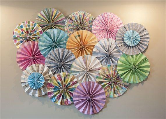 A fabulous Paper Pinwheel Wedding Backdrop DIY from Emma of @Emmaline Bride!