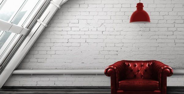 white faux brick wall loft style interior design ideas red leather armchair
