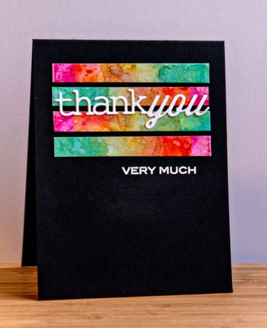 handmade ThankYou card ... black base ... clean lines ... strips of bright alcohol ink marbling ... die cut thank you in white ... luv the mod look!