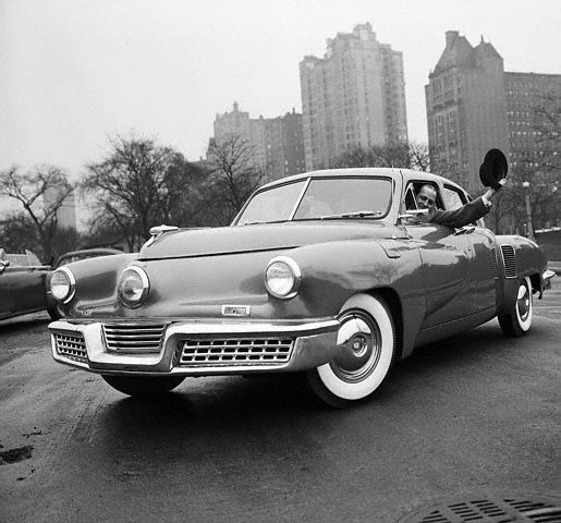 """Preston Tucker in a 48 Tucker Torpedo. The """"big 3"""" should still be ashamed of what they did to this man and his innovative automobile."""