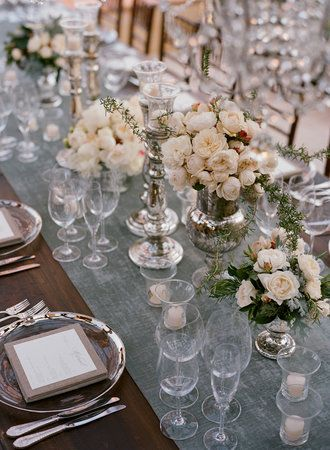 Cute mix of glass, silver and white (can substitute the white for pink to go with our theme). I like how the floral decorations don't seem over the top but adds color