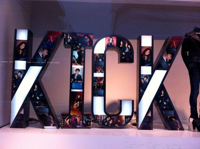 Calvin Klein, small video screens within lightbox lettering